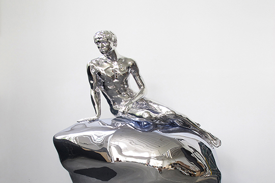 A silver sculpture titled He by Elmgreen & Dragset