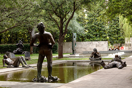 Four figures from Nicole Eisenman's 'Sketch for a Fountain' surround the Nasher fountain